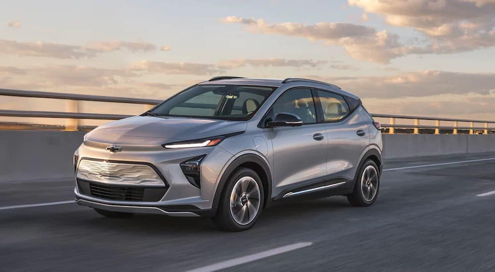 A silver 2022 Chevy Bolt EUV is shown driving on a highway.