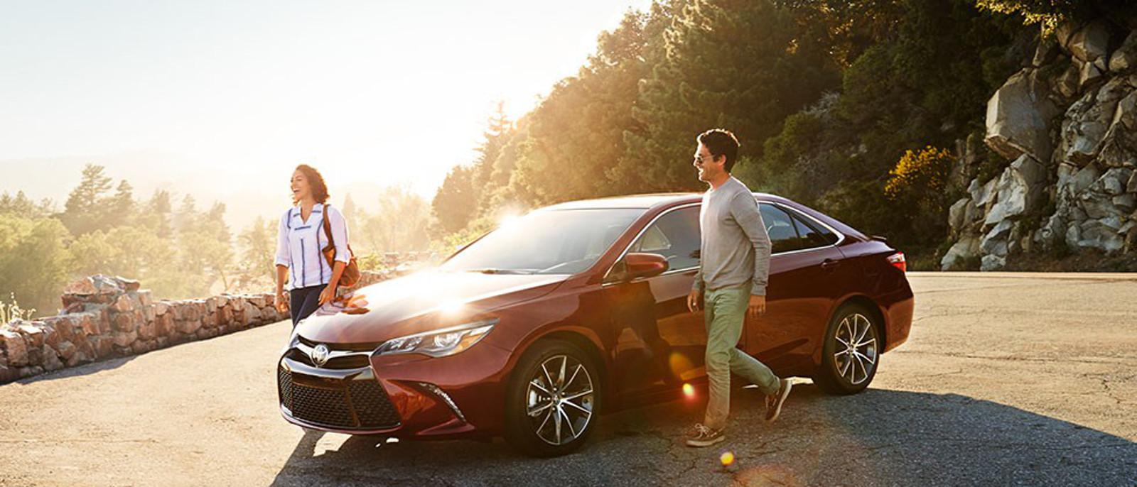 Couple exit 2015 Toyota Camry Hybrid