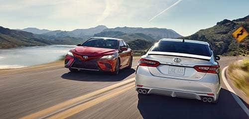 2018 Toyota Camry models driving on a curvy road