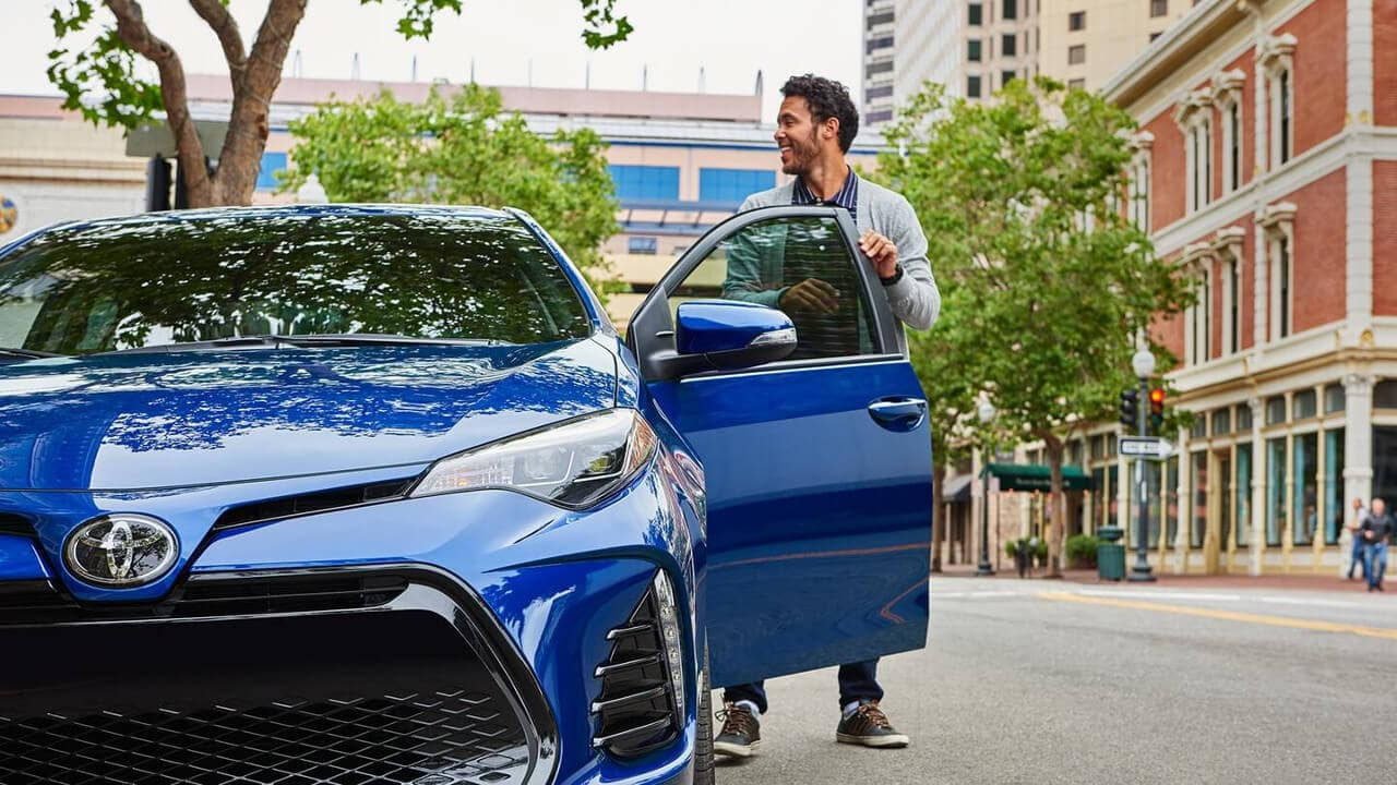Entering a blue 2018 Toyota Corolla