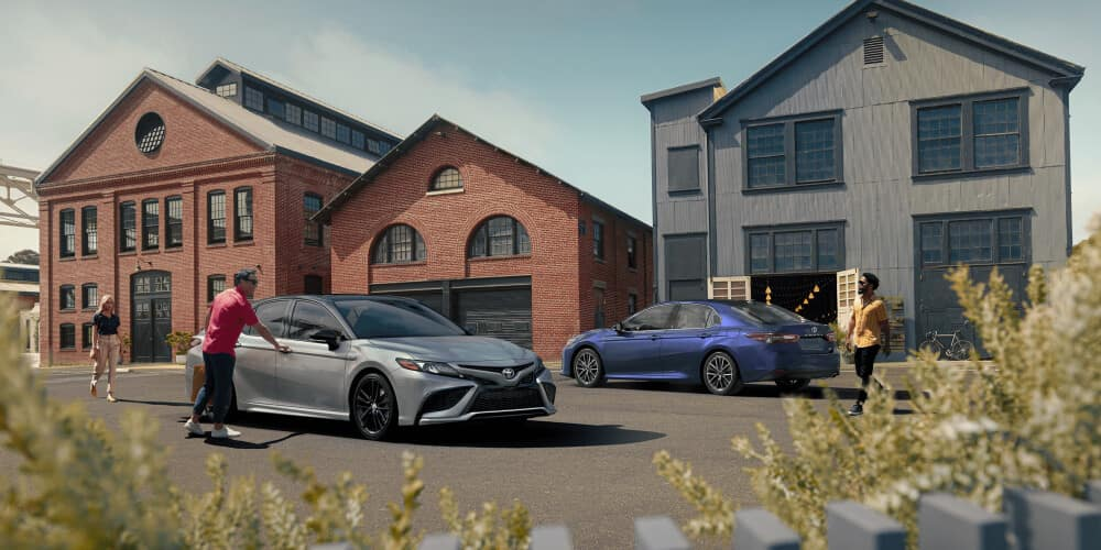 2021 Toyota Camry parked next to warehouse