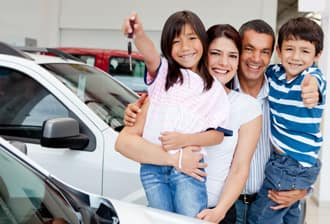 Hispanic family buying a car