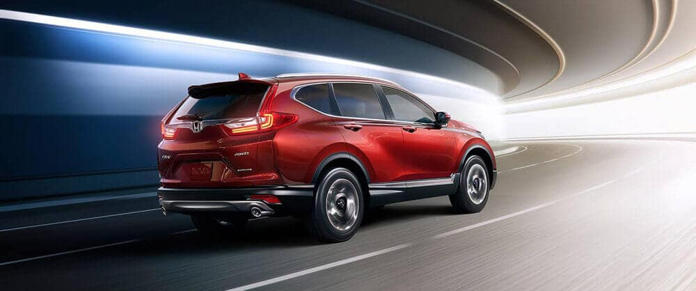 Red 2018 Honda CR-V traveling through a tunnel