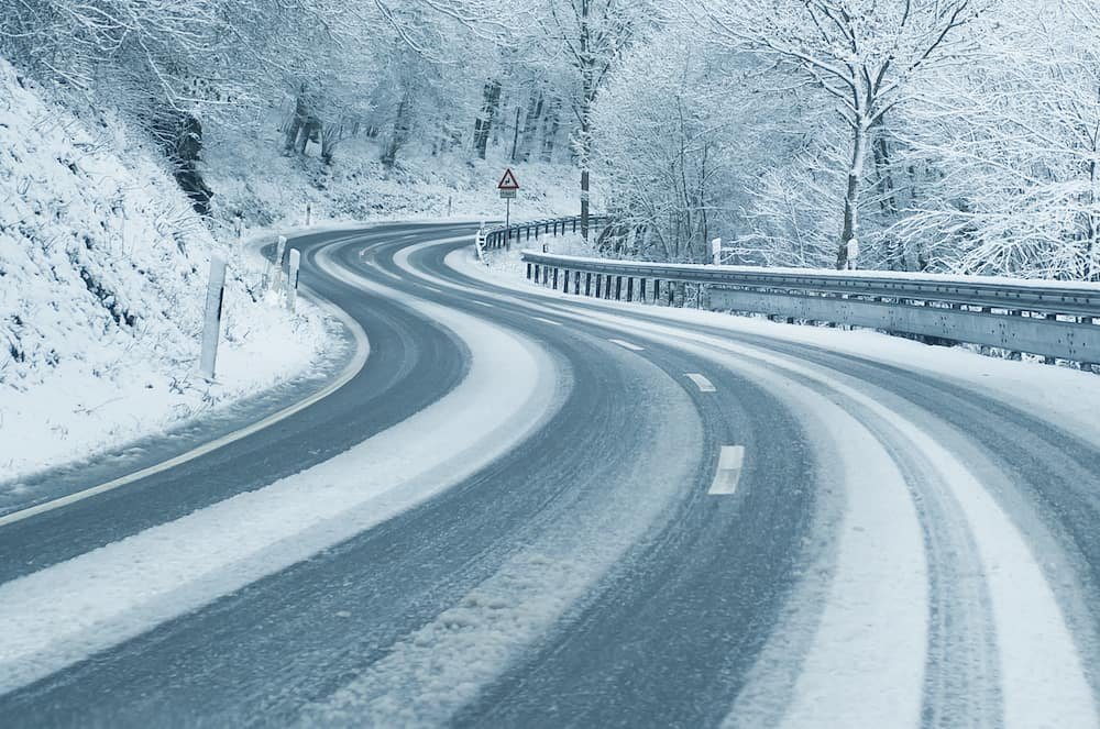 Curvy mountain road with snow