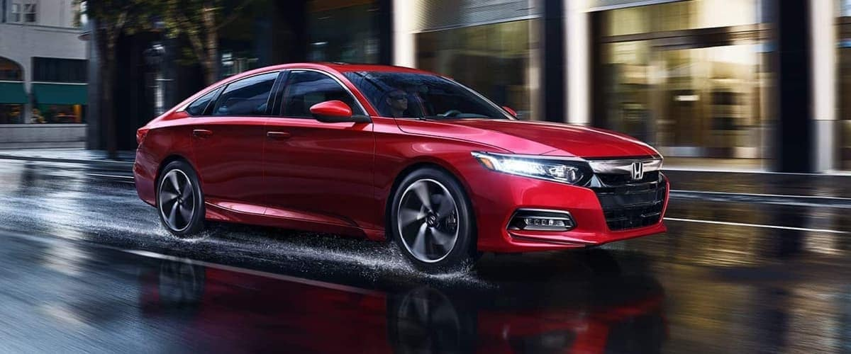 Red 2019 Honda Accord on wet road
