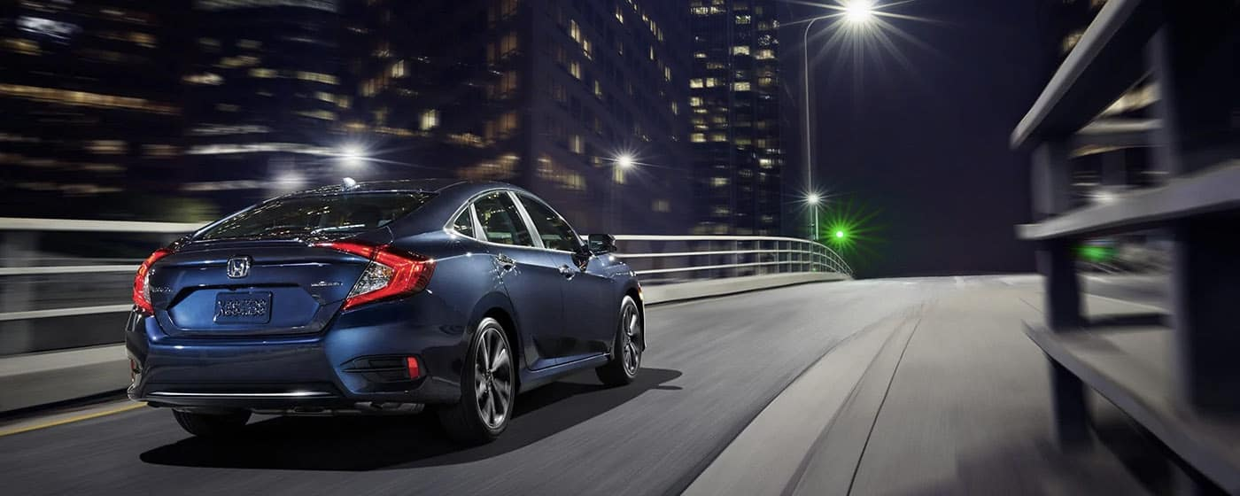 2020 Honda Civic driving fast in city at night