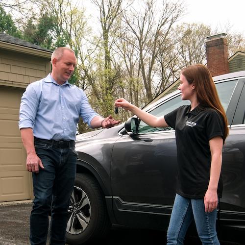 daughter giving dad keys