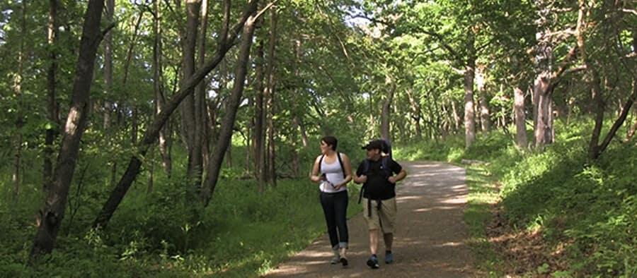 man and woman walk trail Moraine Hill