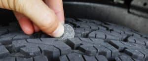 Person measuring tire depth
