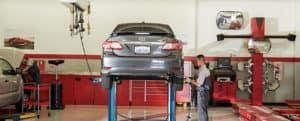 Toyota Service technician removes tire