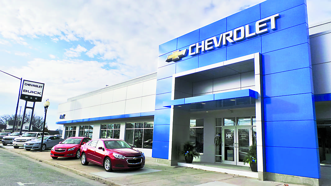 An exterior shot of a Chevrolet dealership in the afternoon.