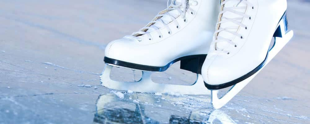 White ice skates on skating rink