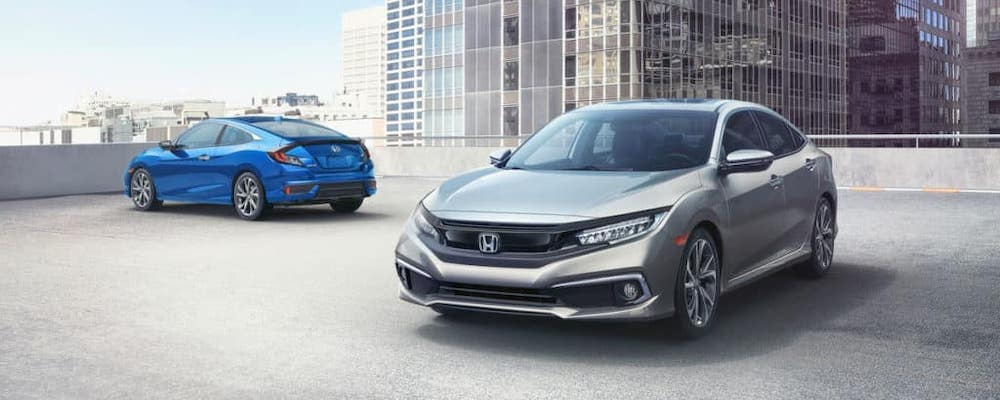 blue and silver 2019 Honda Civic models on roof top parking