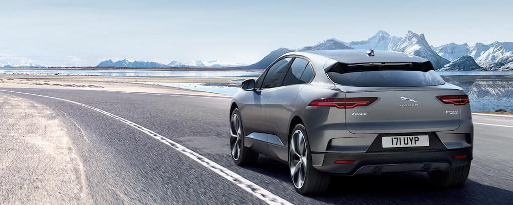 2019 jaguar i-pace on open highway with snowy mountains in background