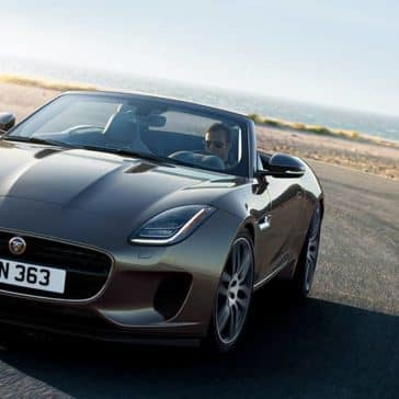 2020-Jaguar-F-TYPE-R-Dynamic-in-Silicon-Silver-driving-around-corner