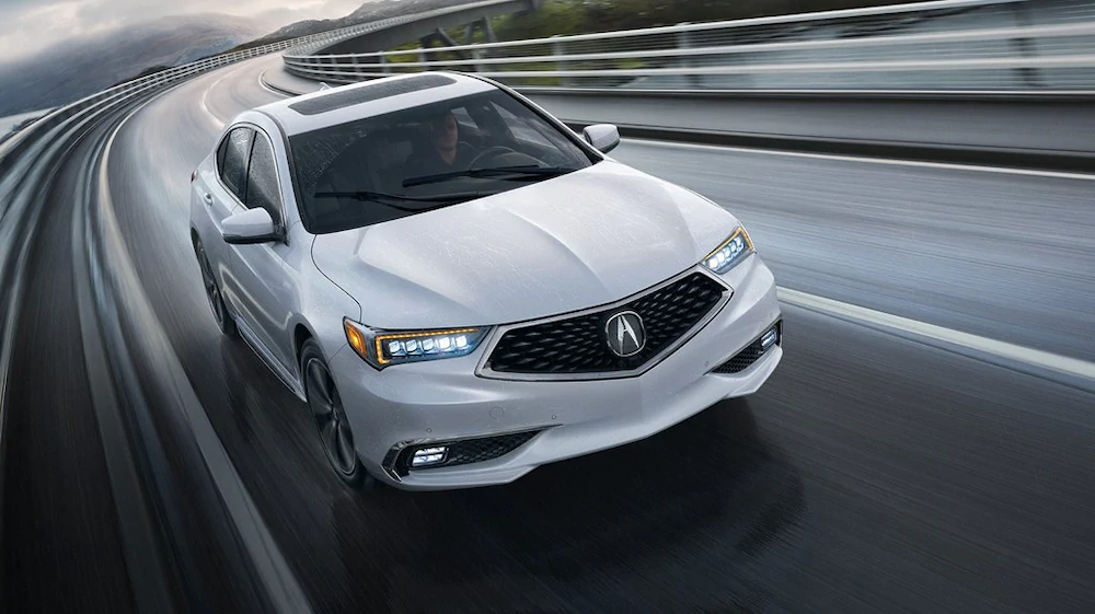 White 2019 TLX on the road