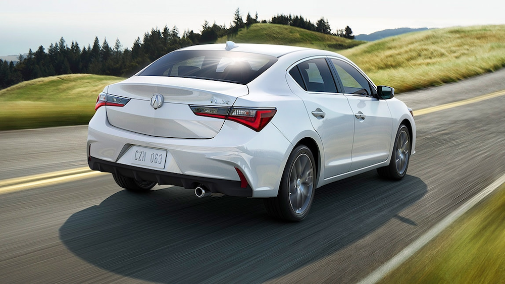 2020 Acura ILX driving down a country road