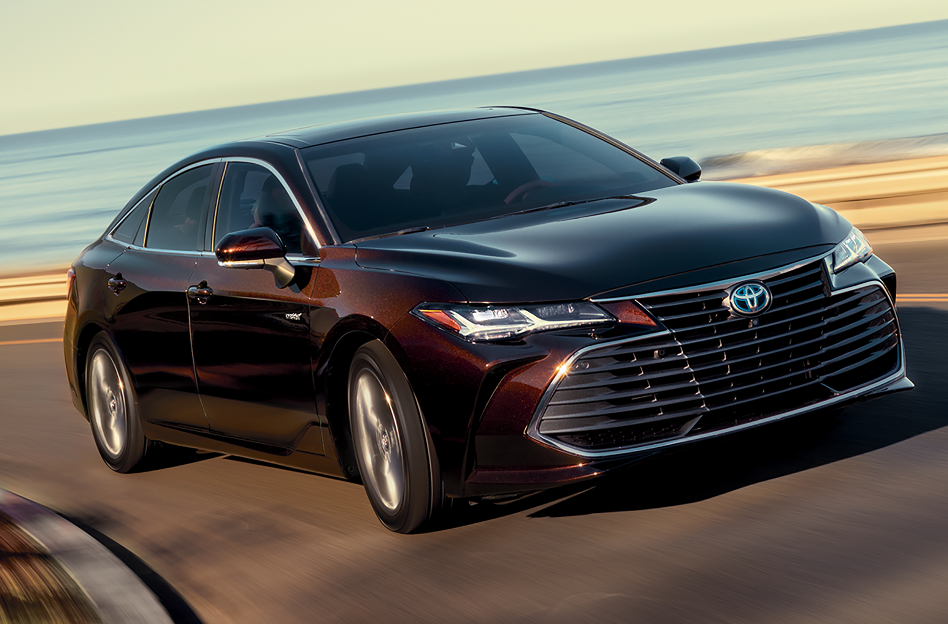 2019 Toyota Avalon Hybrid driving on a Coastal Highway