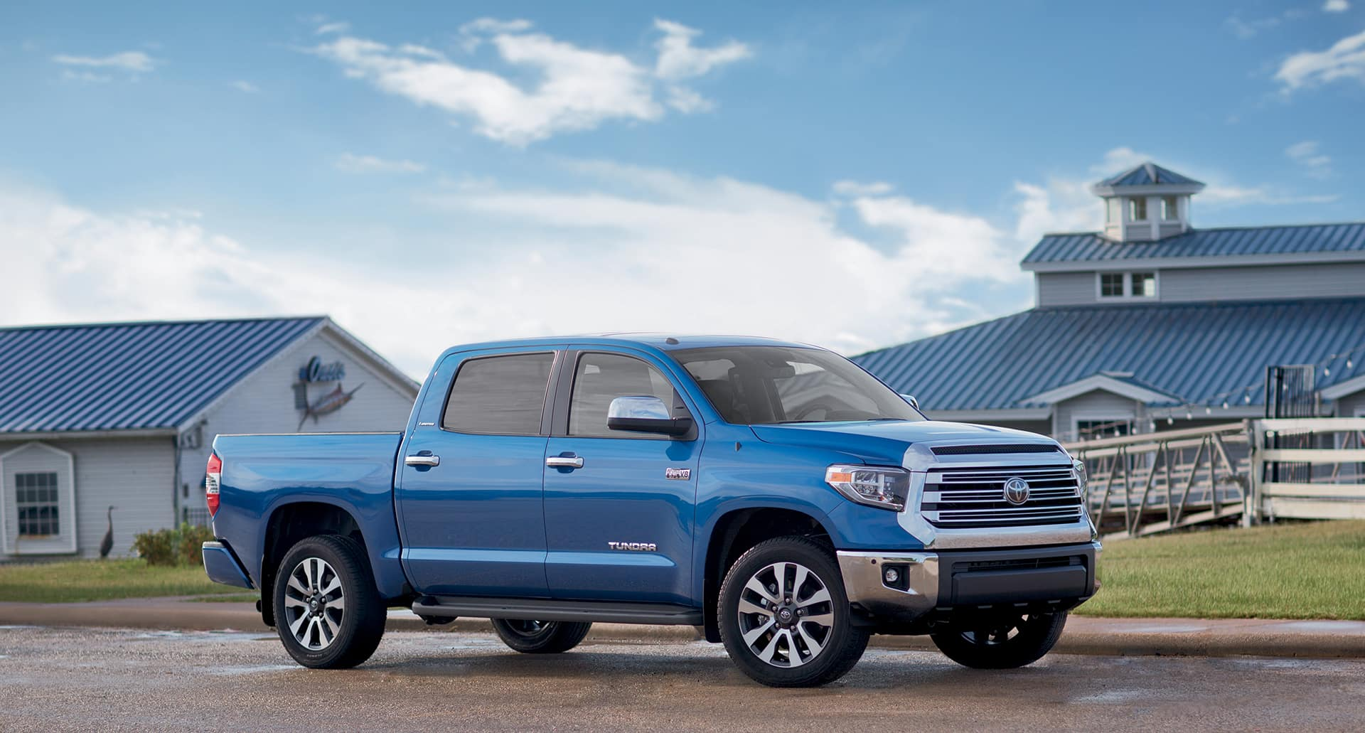 Blue 2018 Toyota Tundra parked in front of a Barn