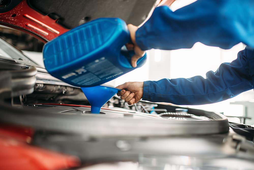 Synthetic Oil versus Conventional Oil at Lancaster Toyota in East Petersburg | technicians changing engine oil