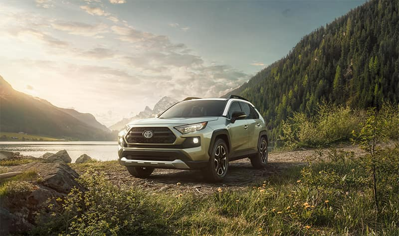 Accessories that help keep your Toyota protected at Lancaster Toyota in East Petersburg | Toyota Rav4 parked on grass