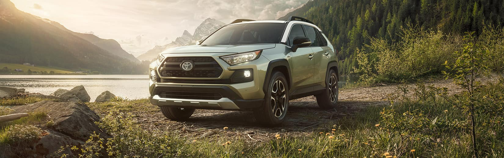 Comparison of the Toyota RAV4 and the Honda CR-V crossovers at Lancaster Toyota | Green 2019 RAV4 parked in nature