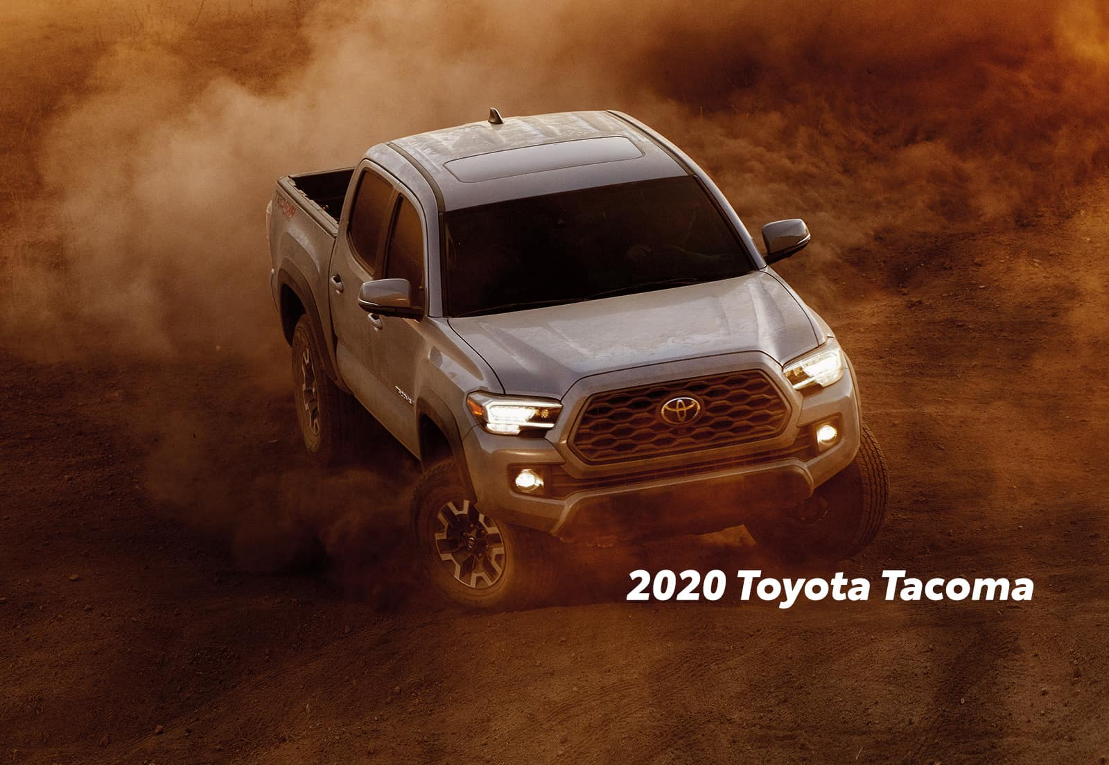Comparison of the Toyota Tacoma vs. Tundra trucks at Lancaster Toyota of East Petersburg | 2020 Toyota Tacoma running on a dusty road