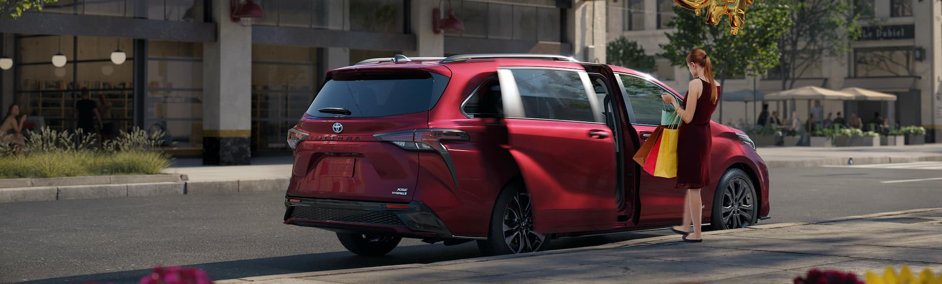 Compare the Toyota Sienna with the Honda Odyssey at Lancaster Toyota of East Petersburg | Woman entering 2021 Toyota Sienna