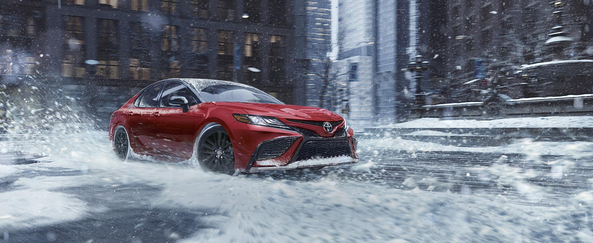 2021 Toyota Camry versus 2021 Honda Accord Comparison at Lancaster Toyota in East Petersburg | 2021 Toyota Camry on snowy city road
