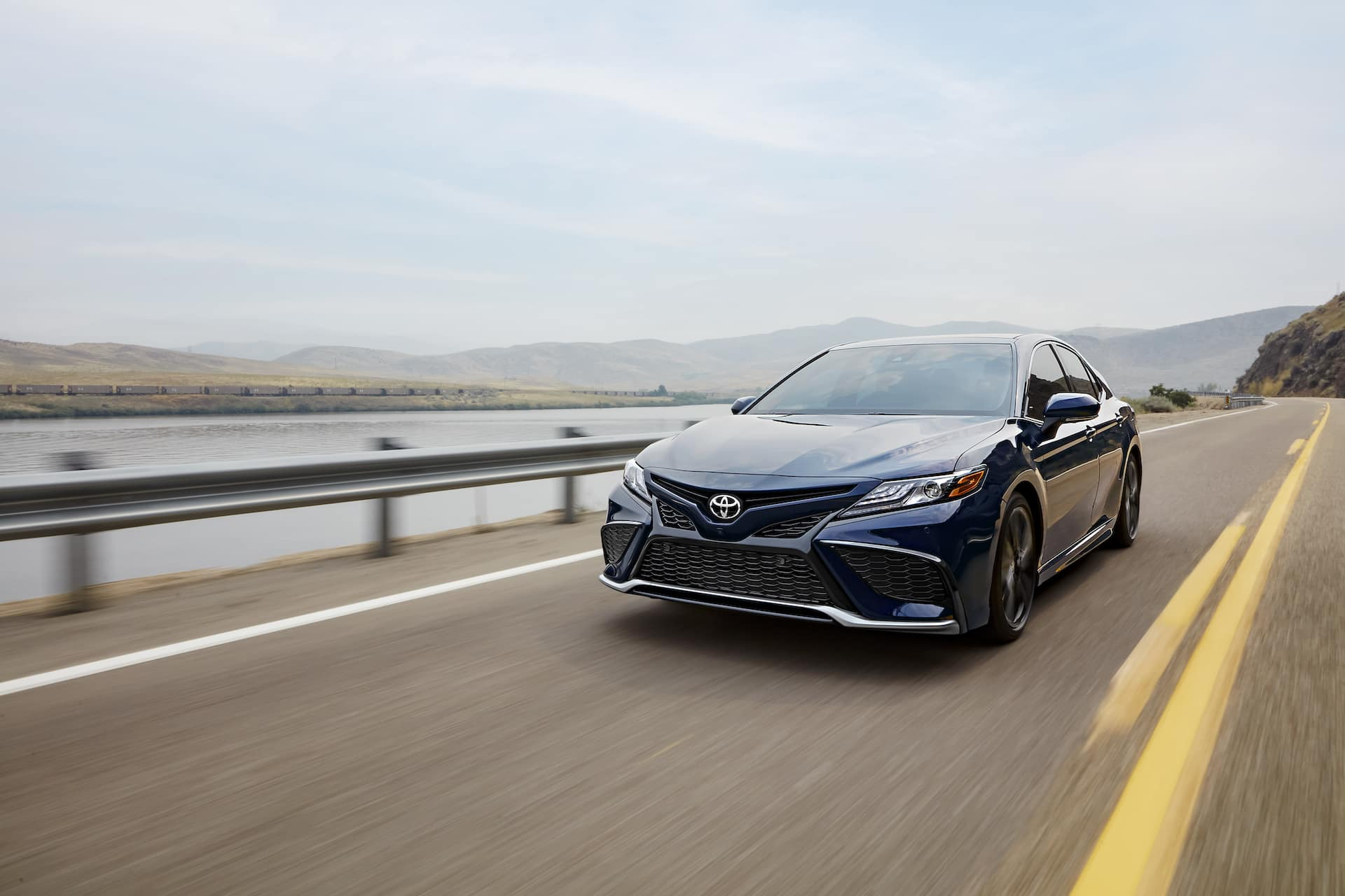 2021 Toyota Camry versus 2021 Honda Accord Comparison at Lancaster Toyota in East Petersburg | 2021 Toyota Camry driving by river