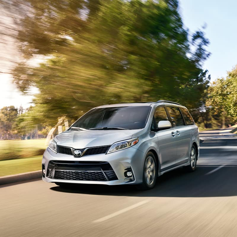 Lancaster Toyota is a Car Dealership in Lancaster near Cornwall PA | Silver 2020 Sienna Driving Down Country Road