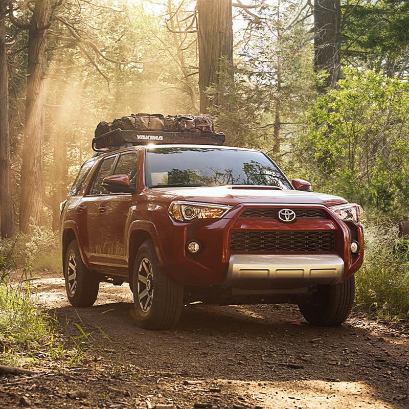 Lancaster Toyota is a Car Dealership in Lancaster near Cornwall PA | Red 2020 4Runner Off-Roading
