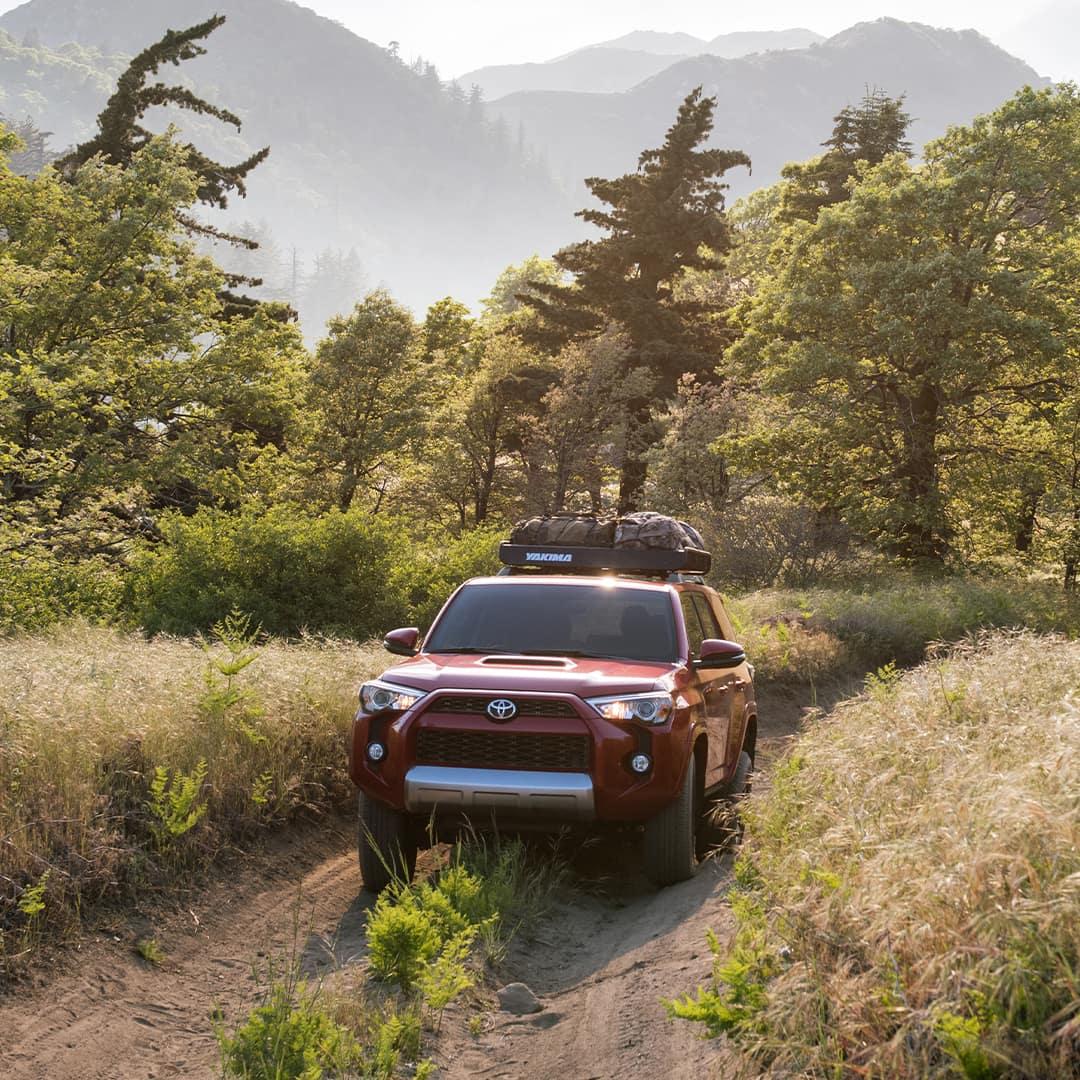 Lancaster Toyota is a Toyota Dealership in Lancaster near Mountville, PA | Red 2020 4Runner Off-Roading