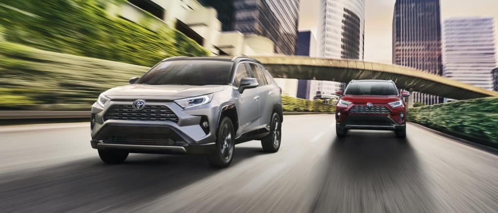 F&I Products page at Lancaster Toyota in East Petersburg | 20220 RAV4s driving on city highway