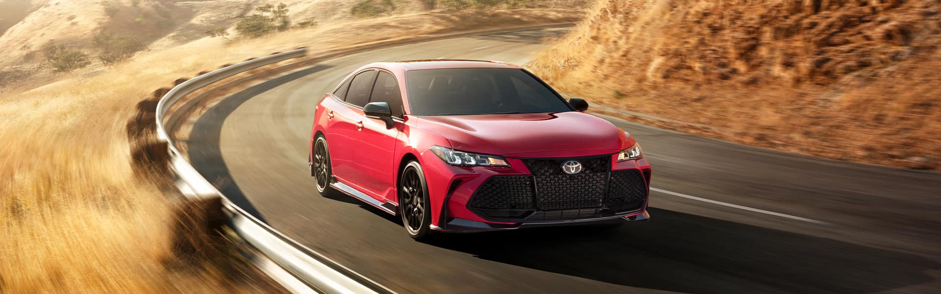 Lancaster Toyota is a Car Dealership in Lancaster near York PA   Red 2020 Avalon Driving Around Bend