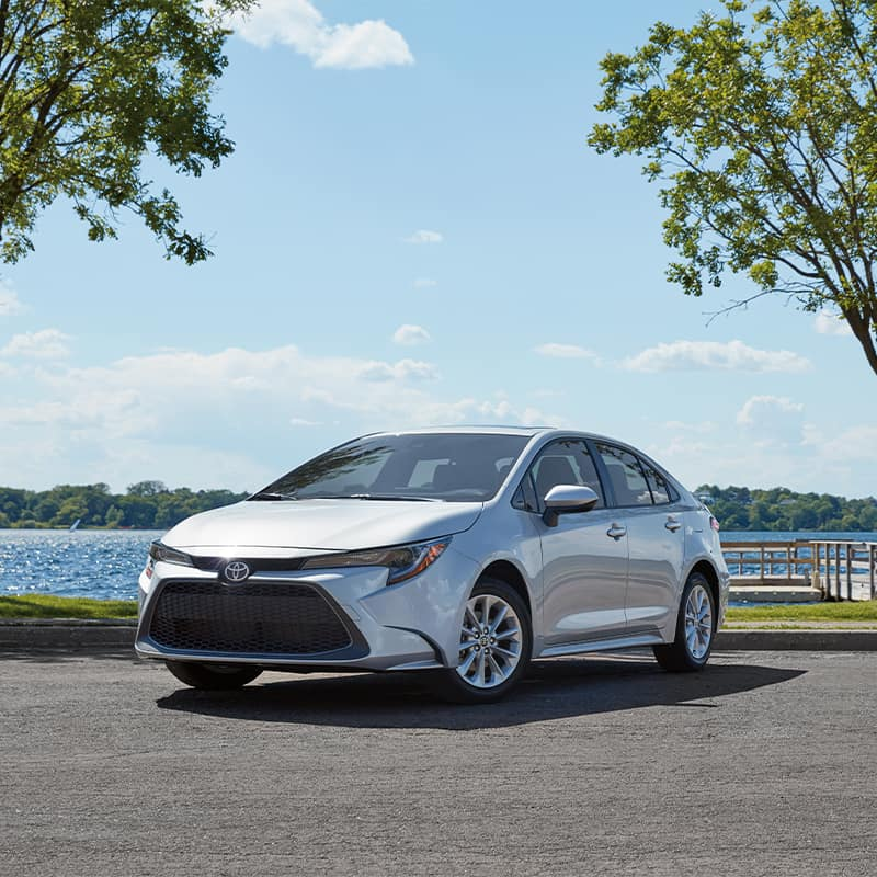 Lancaster Toyota is a Car Dealership in Lancaster near Roherstown, PA | Silver 2020 Toyota Corolla parked by lake