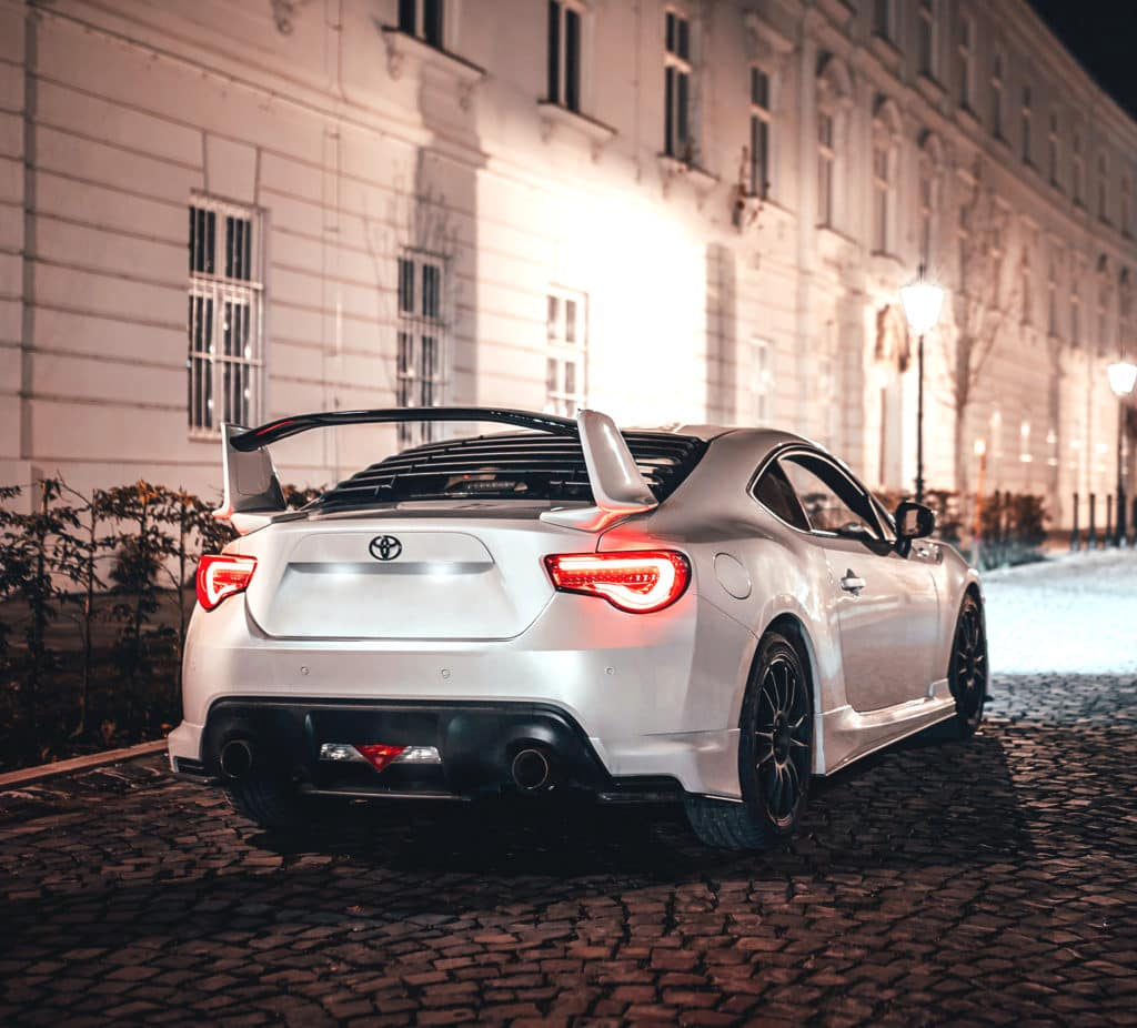 What you can get to personalize your vehicle at Lancaster Toyota in East Petersburg, PA | Rear view of custom Toyota Supra parked on coblestone street at night