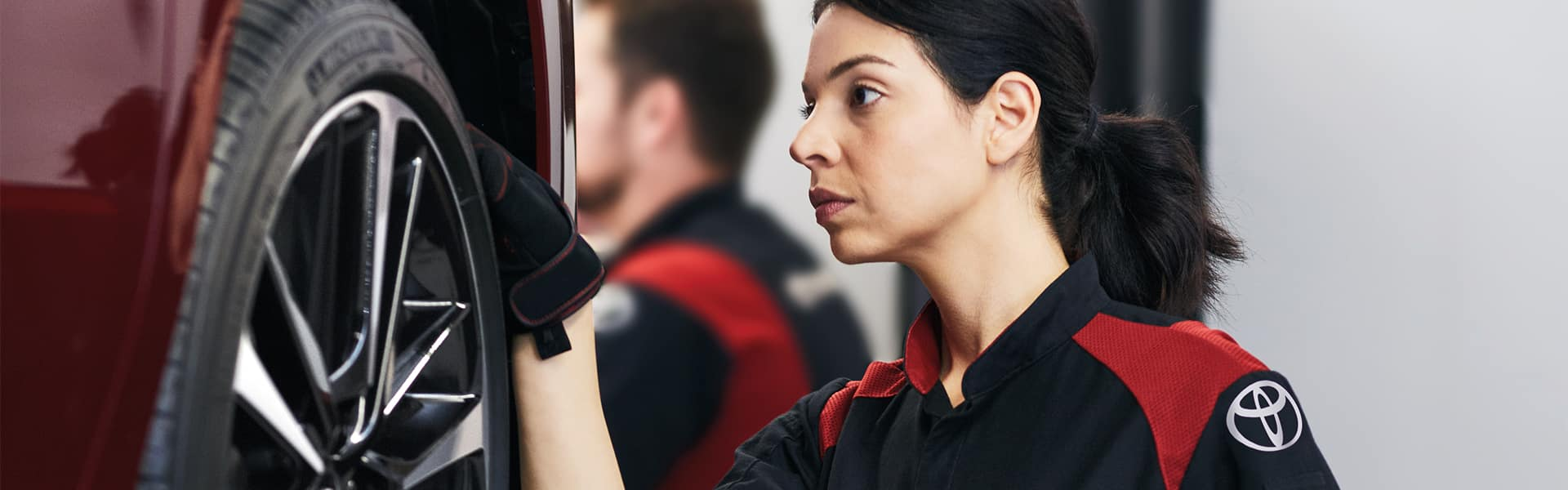 Lancaster Toyota is a Car Dealership in Lancaster near York PA   Toyota Service Advisor Working on Tire of a Toyota Vehicle