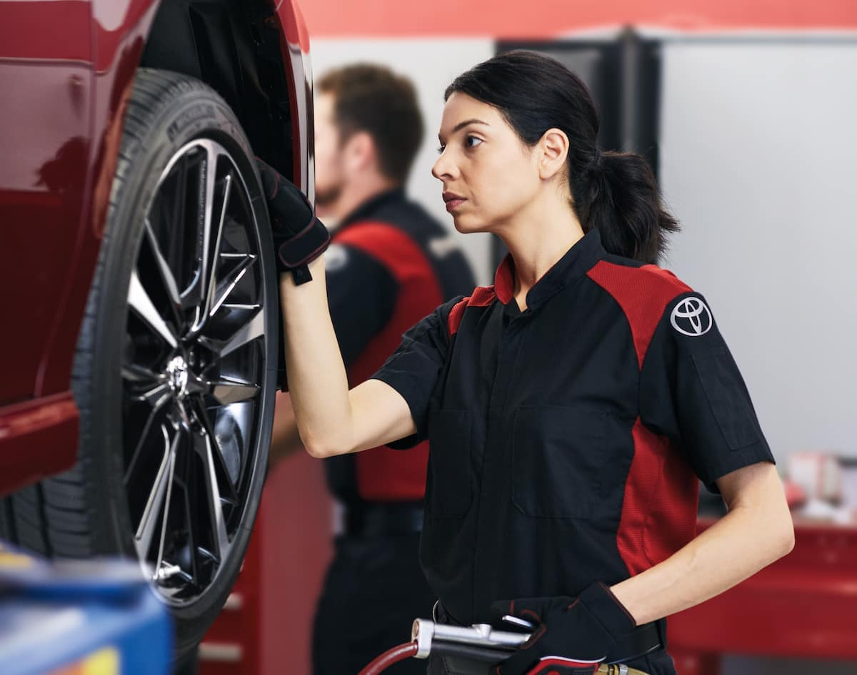 How to prepare your Toyota for the winter season in East Petersburg at Lancaster Toyota | Technician checking car tire