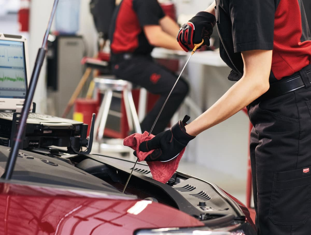 How to prepare your Toyota for the winter season in East Petersburg at Lancaster Toyota | Technician checking engine oil