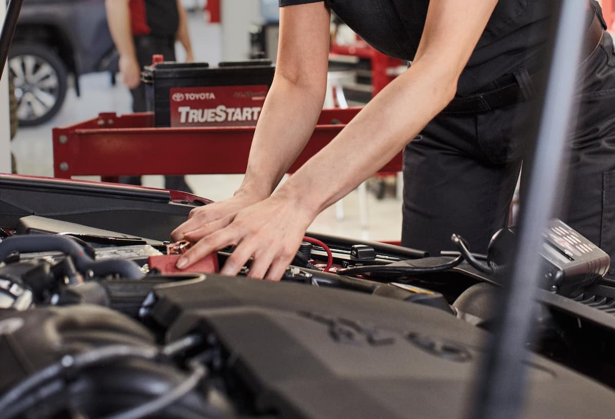 How to prepare your Toyota for the winter season in East Petersburg at Lancaster Toyota | Technician checking car belt hoses