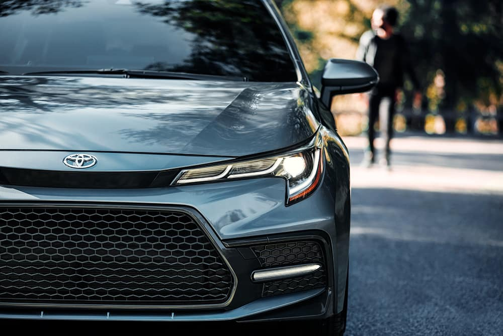 Compare the 2020 Honda Civic Sedan vs. the 2020 Toyota Corolla at Lancaster Toyota of East Petersburg | close up of the grey corolla