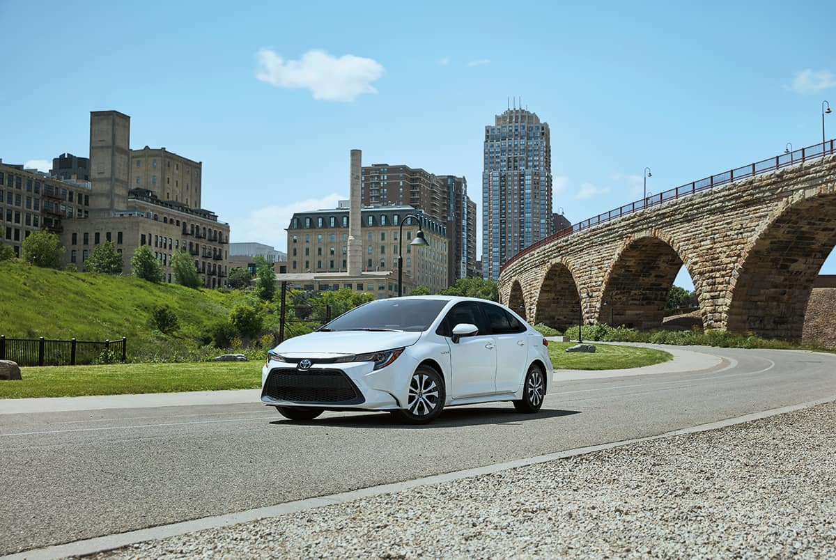 A Toyota Hybrid for Everyone: Quick Facts at Lancaster Toyota | 2020 corolla hybrid parked on the street