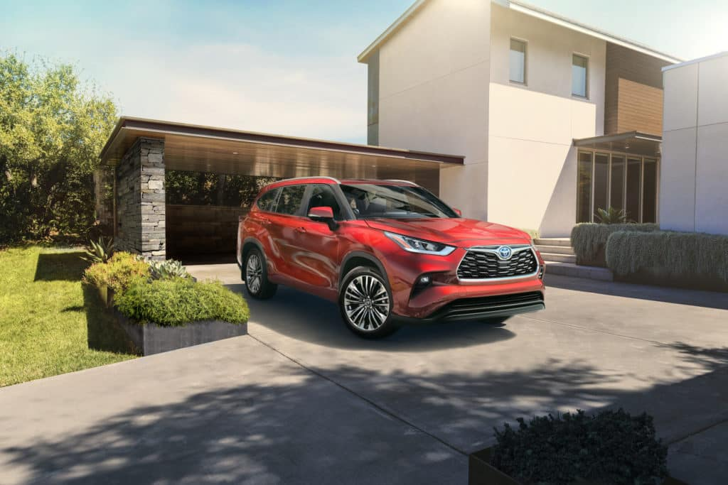 Lancaster Toyota is a Car Dealership in Lancaster near Roherstown, PA | Red 2020 Toyota Highlander hybrid parked in driveway
