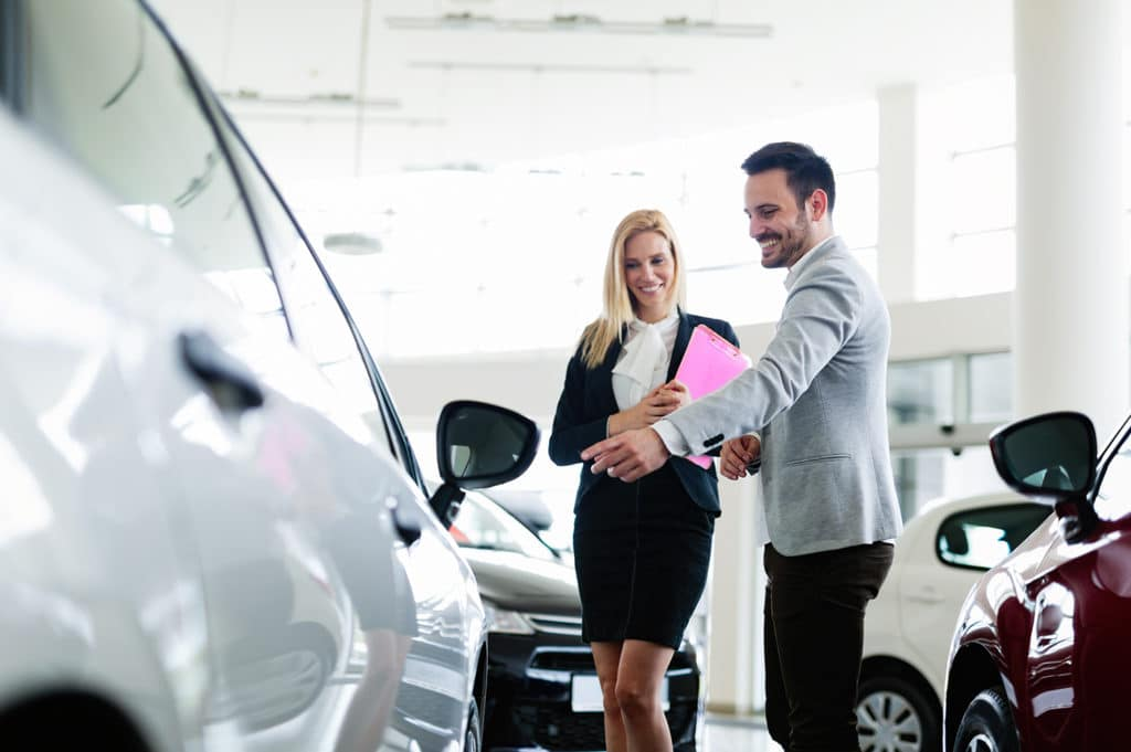 Lancaster Toyota is a Car Dealership in Lancaster near Roherstown, PA | Sales advisors looking at Toyota vehicles in showroom