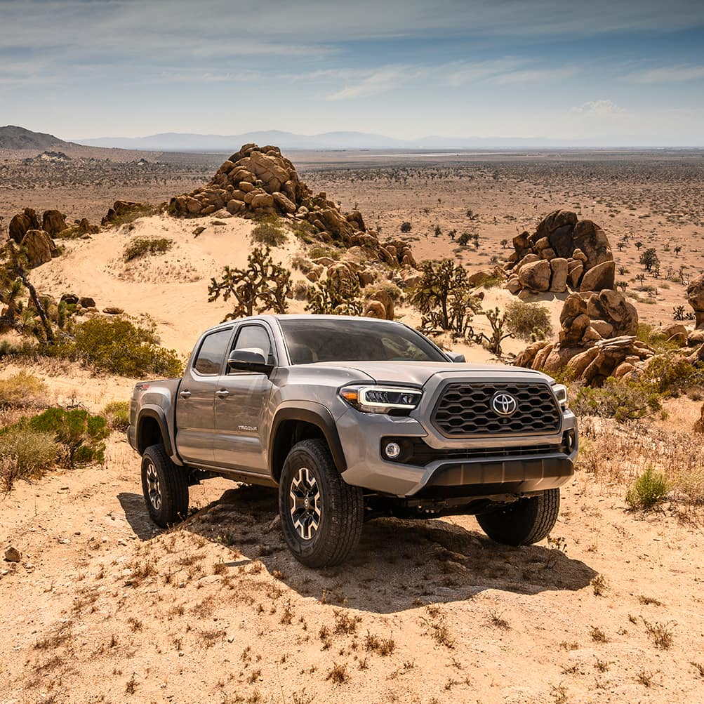 Lancaster Toyota is a Car Dealership in Lancaster near Willow Street PA | 2020 Toyota Tacoma parked on a rock in the dirt