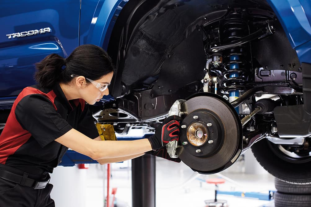 Lancaster Toyota is a Car Dealership in Lancaster near Wrights Ferry or Columbia PA | Toyota mechanic fixing brakes on a Tacoma