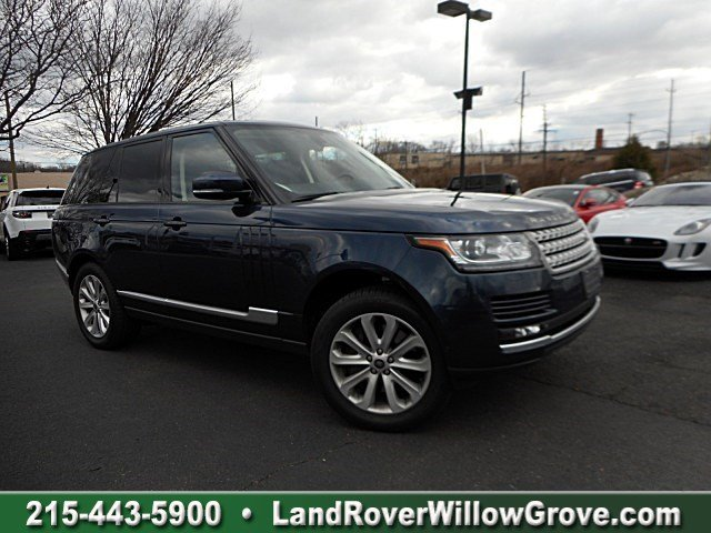 CERTIFIED PRE-OWNED 2013 LAND ROVER RANGE ROVER HSE WITH NAVIGATION & 4WD