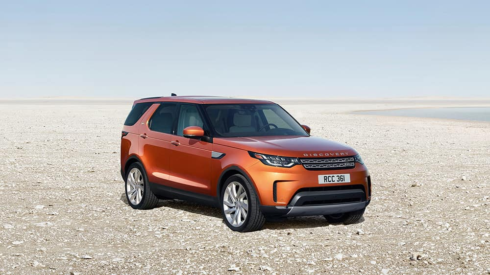 2019 Land Rover Discovery parked on the beach