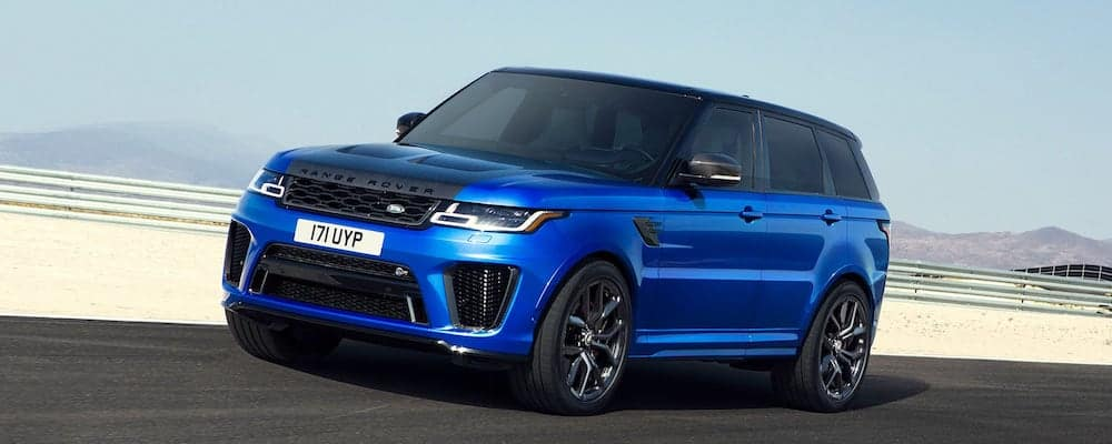 bright blue 2019 range rover sport driving on open highway